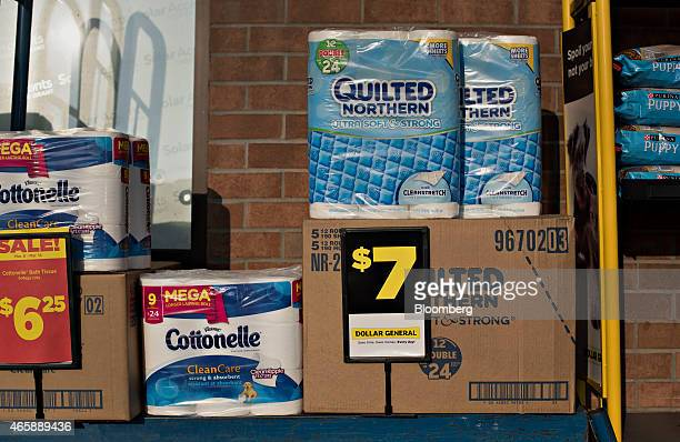 Products are displayed for sale on a cart outside of a Dollar General Corp store in Princeton Illinois US on Wednesday March 11 2015 Dollar General...