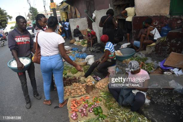 Products are sold on a street in the commune of Petion Ville in the Haitian capital PortauPrince February 17 2019 The government presented a package...