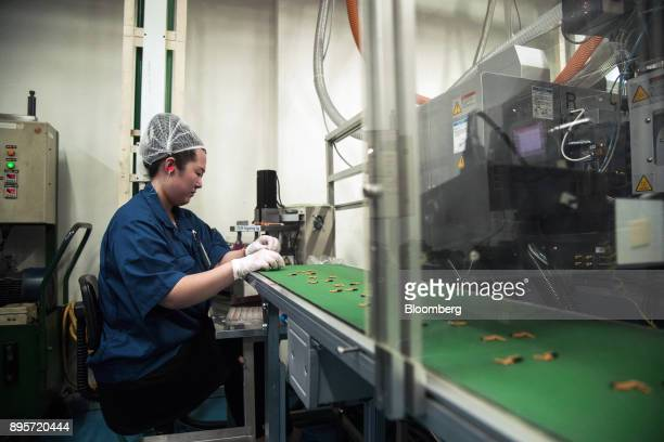 Products moves along a conveyor at the HiP International Ltd production facility in Singapore on Thursday Oct 5 2017 HiP is heading for its largest...