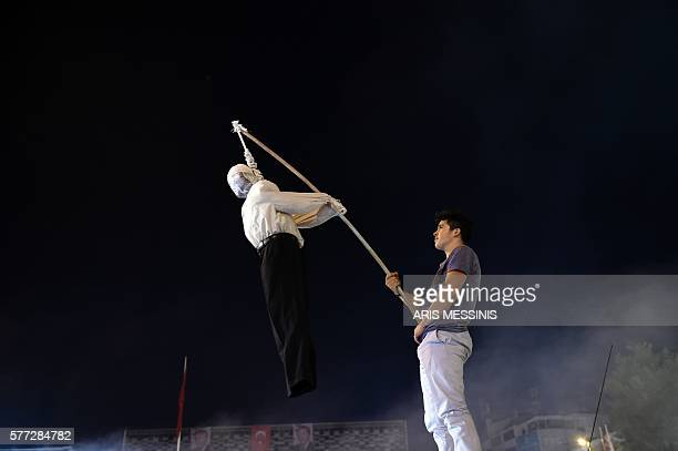 ProErdogan supporter holds an effigy of US based cleric Fetullah Gulen hanged by a noosed on during a rally at Taksim square in Istanbul on July 18...