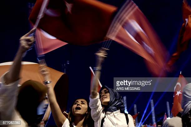 Pro-Erdogan supporters wave Turkish national flags during a rally at Taksim square in Istanbul on July 18, 2016 following the military failed coup...