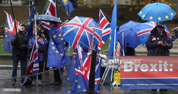 ProEropean Union antiBrexit demonstrators wave European Union and Union flags as they protest outside of the Houses of Parliament in central London...