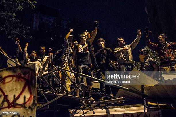 Proesters taunt the police Protests in Istanbul Turkey continue into the night Protests began as a fight to save Gezi Park in central Istanbul After...