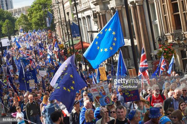 ProEU demonstrators are seen with EU flags during the People's March for Europe against Brexit in central London on September 9 2017 Thousands joined...