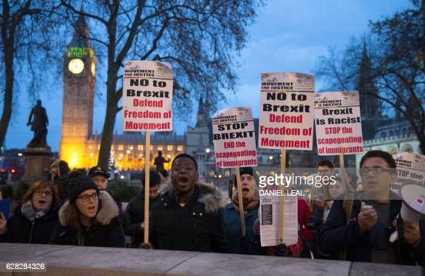 ProEU demonstrators hold up placards and chant together outside the Supreme court in London on the third day of a fourday hearing on December 7 2016...