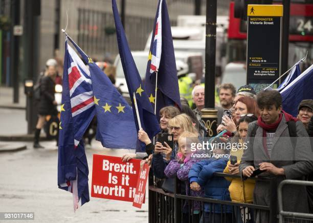 ProEU demonstrators protest outside Westminster Abbey while the Royal Family including The Queen accompanied by the Prince of Wales and The Duchess...