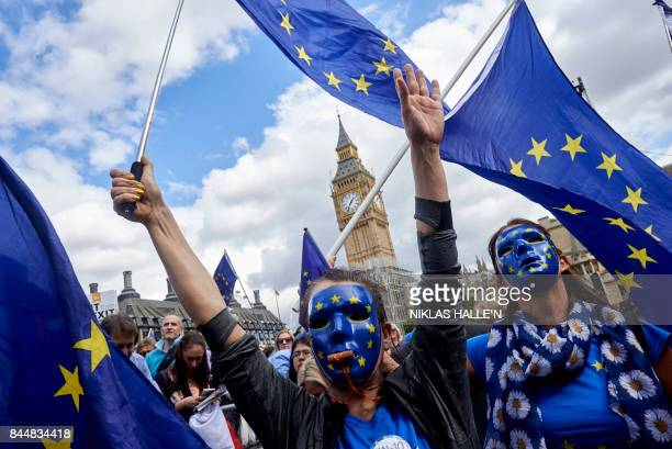 ProEU demonstrators rally during the People's March for Europe against Brexit in Parliament Square in central London on September 9 2017 Thousands...