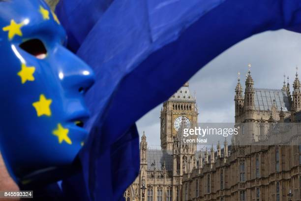 ProEU demonstrators wave flags and chant outside the Houses of Parliament as MPs prepare to debate the EU Bill on September 11 2017 in London England...