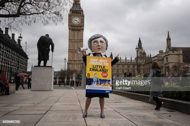 A proEU protester dressed as Prime Minister Theresa May takes part in a demonstration near Parliament on March 29 2017 in London England Later today...