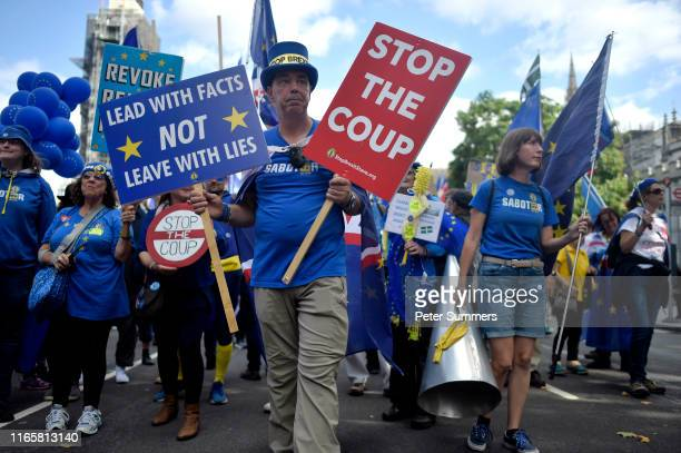 ProEU protester Steve Bray carries a sign that says Stop the Coup and Lead with Facts not Leave with Lies march past the Houses of Parliament on...