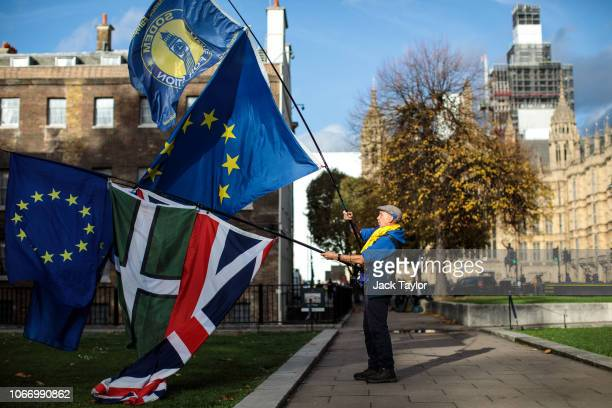 ProEU protesters demonstrate against Brexit with flags outside the House of Parliament on November 13 2018 in London England Downing Street has said...