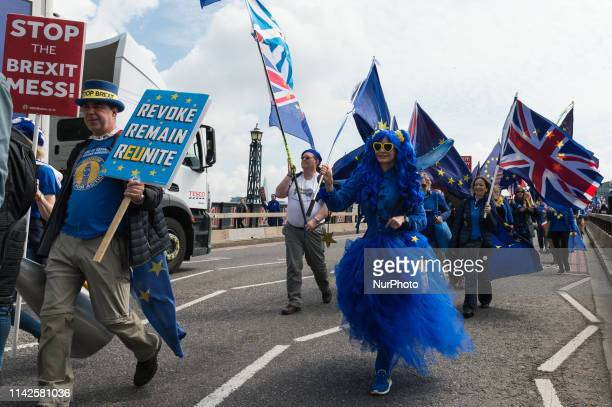 ProEU supporters protesting against Brexit march on Lambeth Bridge in central London after a meeting with European Parliament's chief Brexit...