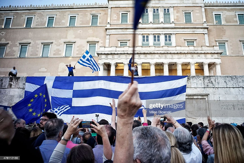 Pro-Euro protesters take part in a rally in front of the Parliament on June 22. 2015 in Athens, Greece. Thousends of people attended the rally in support of Greece remaining in the European Union. The Eurozone's 19 national leaders held an emergency summit in Brussels to discuss the crisis and welcomed new proposals from the Greek government after talks today to haul Athens back from the brink of bankruptcy.