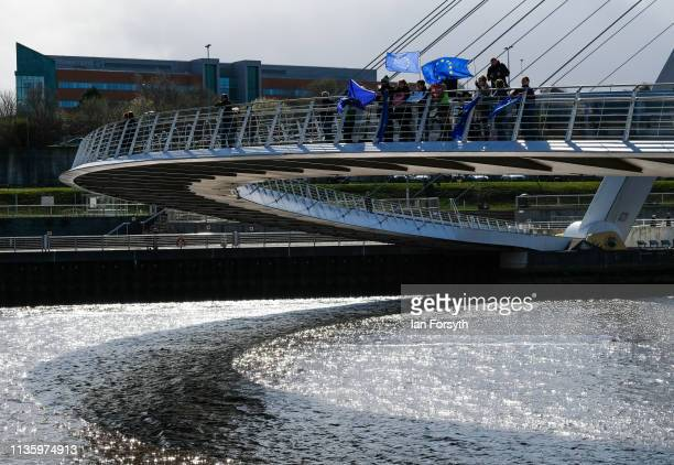 ProEurope supporters shout from the Millennium Bridge over the River Tyne as a flotilla of fishing boats from the Fishing For Leave protest group...