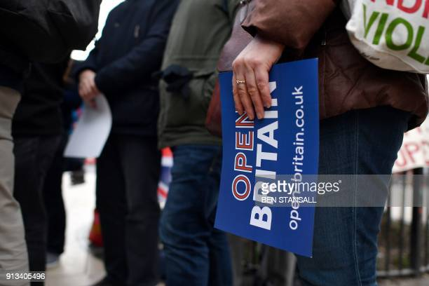A proEuropean activist campaigns on the streets of Brixton south London on February 2 2018 ProEuropean British campaign groups agreed February 2 to...