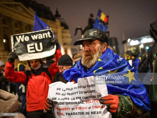 Pro-Europeans protest against the rulling coalition Social Democrat Party next to the Romanian Atheneum during the ceremony of taking over the...