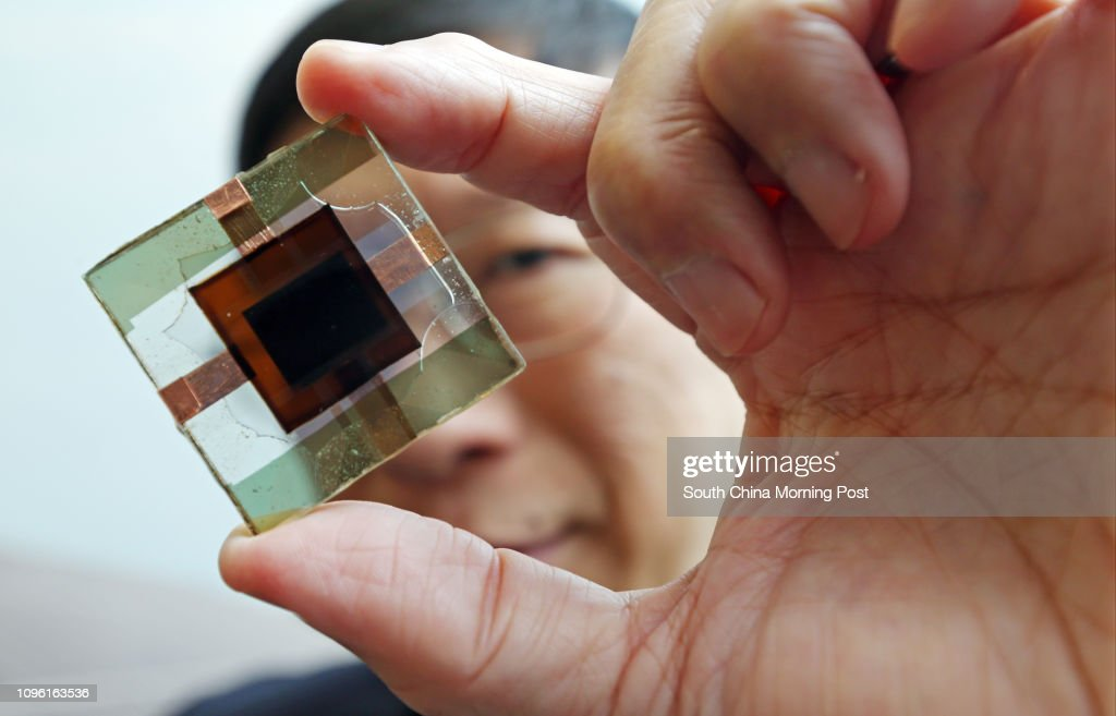 Prof. Charles Chee Surya, poses for a photograph with perovskite-silicon tandem solar cells with the world's highest power conversion efficiency. 12APR16 SCMP/K. Y. Cheng : News Photo