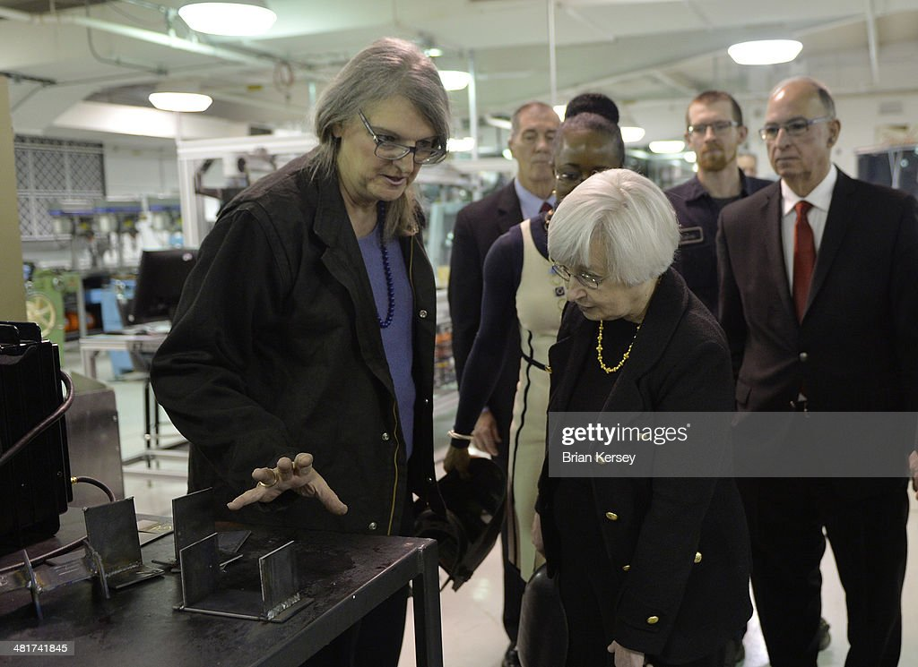 Prof. C.J. Sikora (L) shows Federal Reserve Chair Janet Yellen a weld as she tours the College to Careers Program in Advanced Manufacturing at the City Colleges of Chicago's Daley College on March 31, 2014 in Chicago, Illinois. In earlier remarks Yellen indicated that the economy was far from healthy and that the Fed would continue its policy of maintaining low interest rates.