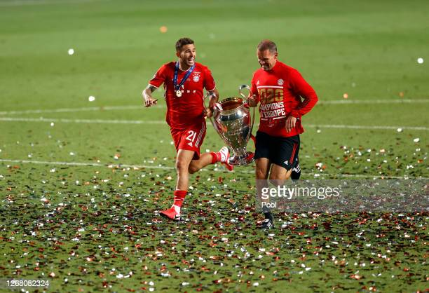 Prof Dr Holger Broich, Scientific Director and Head of Fitness for Bayern Munich and Lucas Hernandez of FC Bayern Munich celebrate with the Champions...
