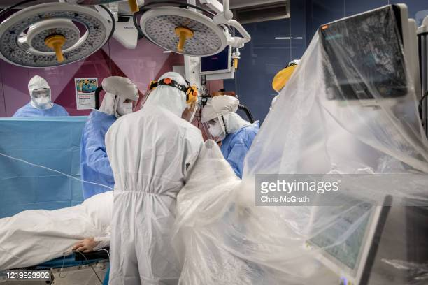 Prof Dr Senol Polat performs a tracheotomy operation on a patient infected with the COVID19 virus at the Acibadem Altunizade Hospital on April 18...