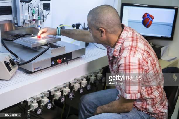 Prof Tal Dvir holds a 3D printed heart made from human tissue in his laboratory in Tel Aviv University on April 15 2019 in Tel Aviv Israel Israeli...