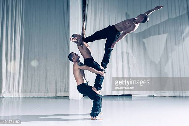 Professional acrobats performs as a team