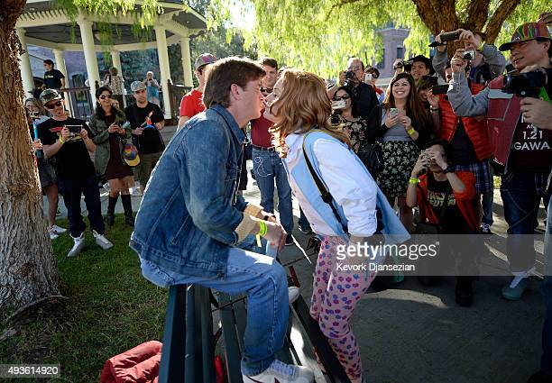 Professional actors Tyler Dunivan as the character Marty McFly and Coral Timson as the character Jennifer Parker act out a scene from the film in the...
