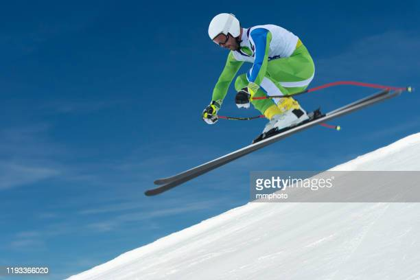 professional adult alpine skier racing downhill - professional sportsperson stock pictures, royalty-free photos & images