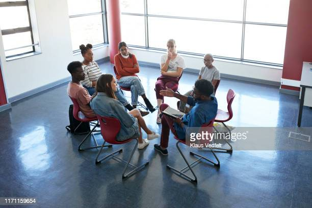 professional advising young students in classroom - community college stock pictures, royalty-free photos & images