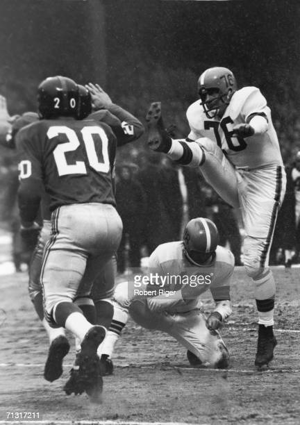 Professional American football player Lou Groza placekicker of the Cleveland Browns kicks the ball during a game mid 20th Century Groza played his...