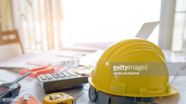professional architect working table .construction and safety concept. - occupational safety and health stock pictures, royalty-free photos & images