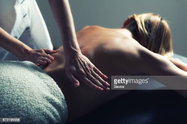 professional back massage - body massage stock photos and pictures