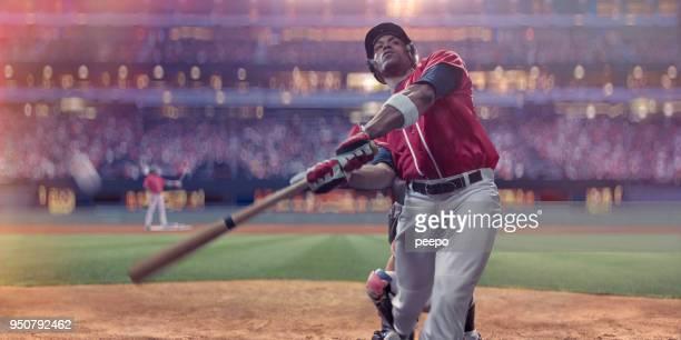 professionell baseball smeten att slå bollen under natt spel i stadium - basebollslag bildbanksfoton och bilder