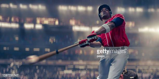 professional baseball batter hitting baseball in mid-swing close up - baseball strip stock pictures, royalty-free photos & images