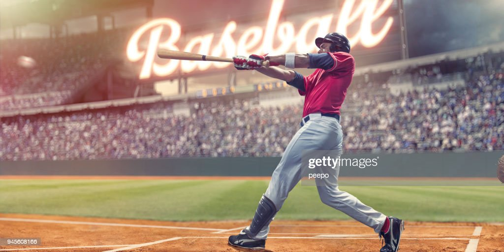 Professional Baseball Batter Striking Baseball During Night Game In Stadium : Stock Photo