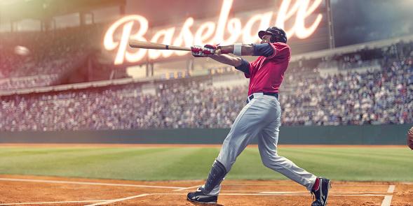 Professional Baseball Batter Striking Baseball During Night Game In Stadium 945608166