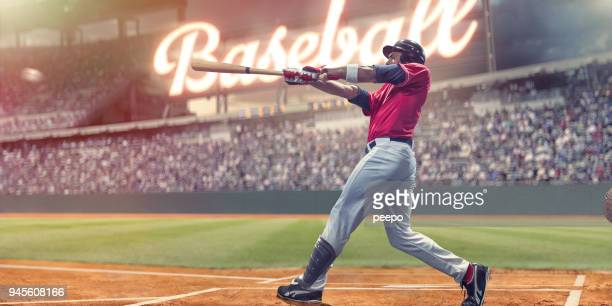 professional baseball batter striking baseball during night game in stadium - baseball player stock pictures, royalty-free photos & images