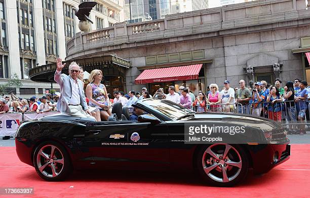 Professional baseball manager Jim Leyland waves to fans as he passes by during the MLB AllStar Game Red Carpet Show on July 16 2013 in New York City