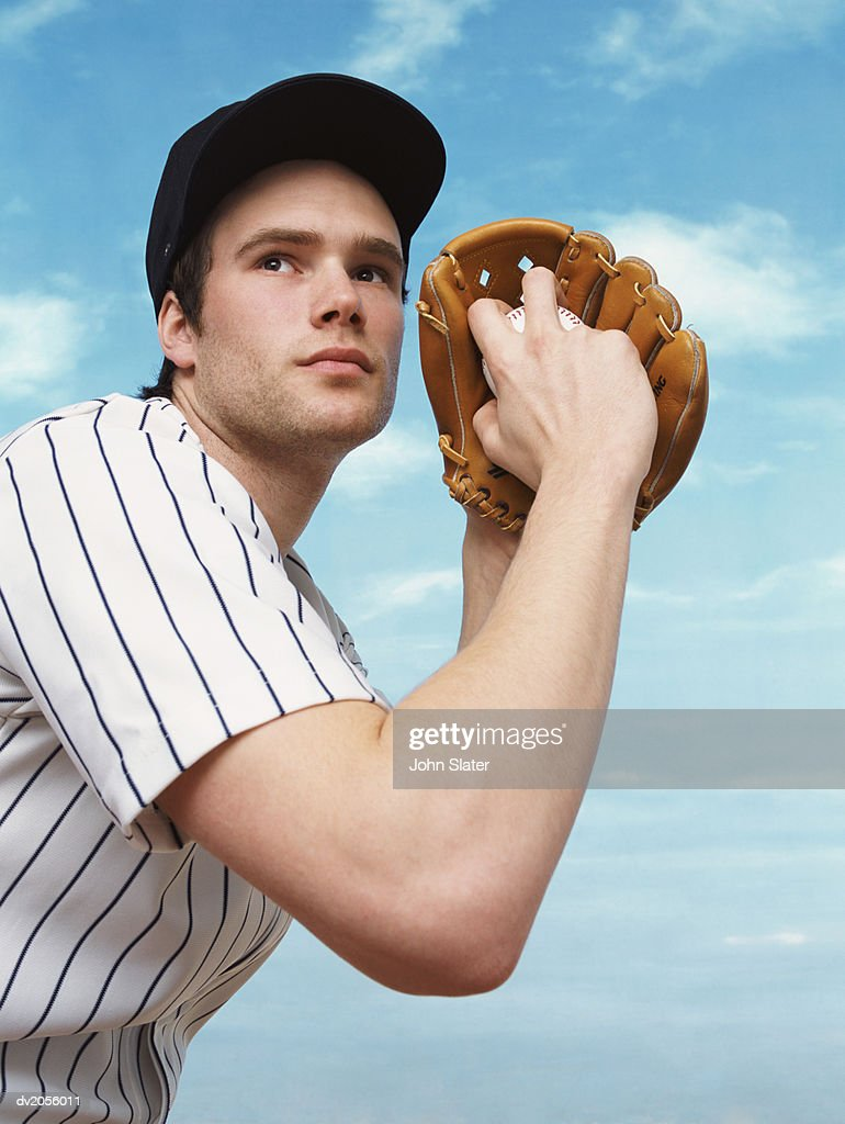 Professional Baseball Pitcher Preparing to Pitch a Baseball : Stock Photo