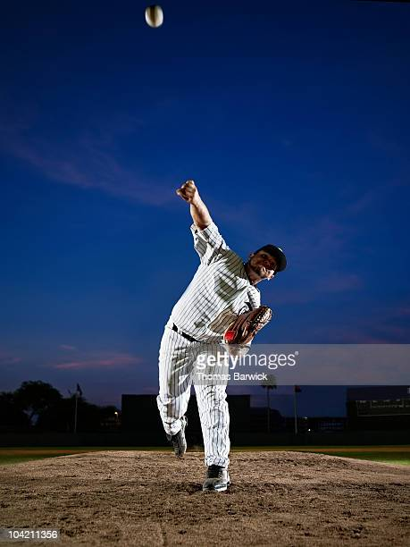 Professional baseball pitcher throwing from mound