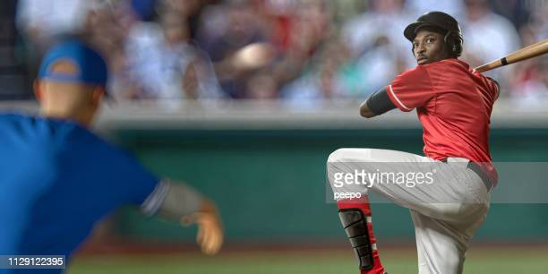 professional baseball player about to strike ball during baseball game - batting stock pictures, royalty-free photos & images