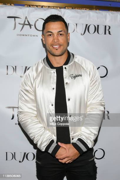 Professional baseball player Giancarlo Stanton poses for a photo as he celecbrates his DuJour Magazine Cover at TAO Downtown on March 26 2019 in New...