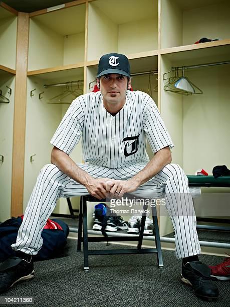 professional baseball player in locker room - スポーツユニフォーム ストックフォトと画像