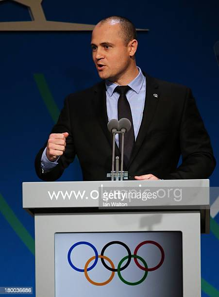 Professional baseball player Justin Huber speaks during a World Baseball Softball Confederation presentation during the 125th IOC Session New Sport...