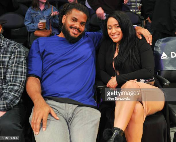 Professional baseball player Kenley Jansen and wife Gianni Jansen attend a basketball game between the Los Angeles Lakers and the Phoenix Suns at...