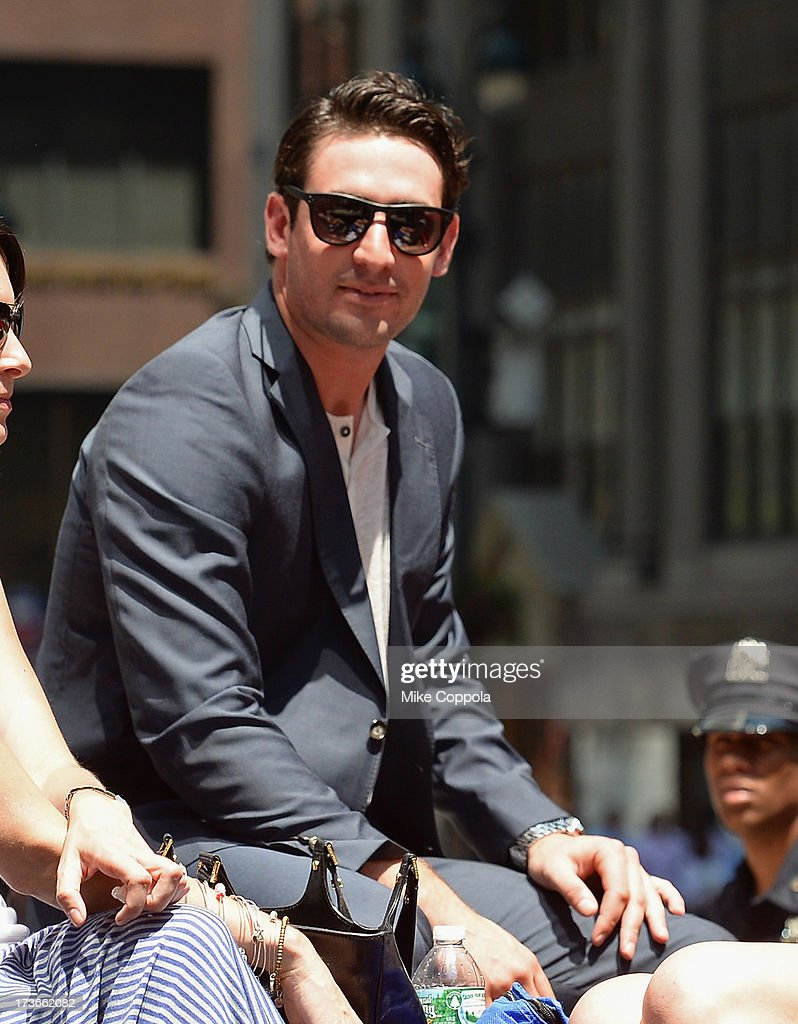 Professional baseball player Matt Harvey waves to fans as he passes by during the MLB All-Star Game Red Carpet Show on July 16, 2013 in New York City.