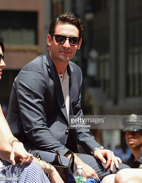 Professional baseball player Matt Harvey waves to fans as he passes by during the MLB AllStar Game Red Carpet Show on July 16 2013 in New York City
