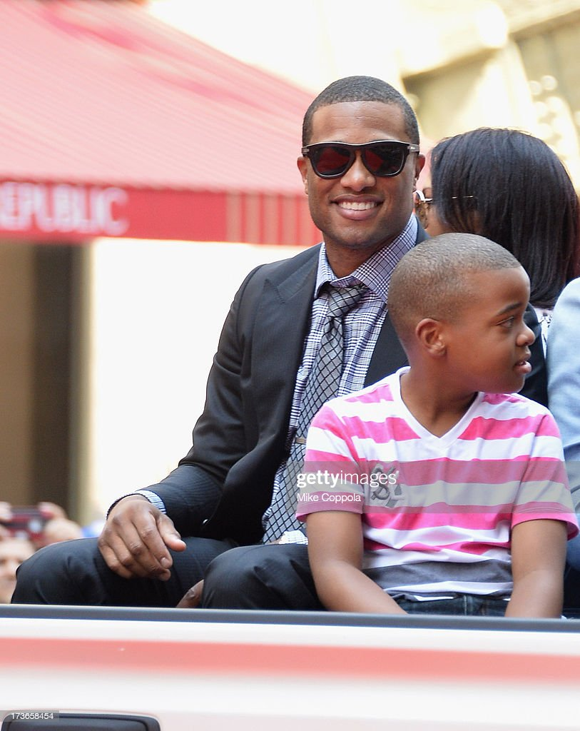 Professional baseball player Robinson Cano waves to fans as he passes by during the MLB All-Star Game Red Carpet Show on July 16, 2013 in New York City.