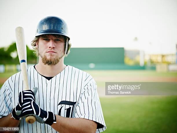 professional baseball player standing with bat - 野球選手 ストックフォトと画像