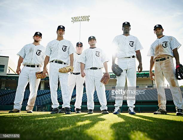 professional baseball players standing on field - baseball uniform stock pictures, royalty-free photos & images